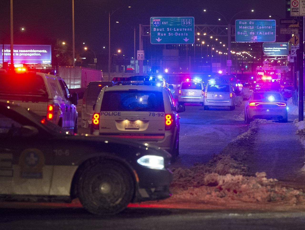 Police cordon off the area where an officer was injured during a traffic stop Thursday, Jan. 28, 2021, in Montreal. Montreal police say they've found a vehicle today believed to have been used by a suspect in an assault on a police officer last week. THE CANADIAN PRESS/Ryan Remiorz
