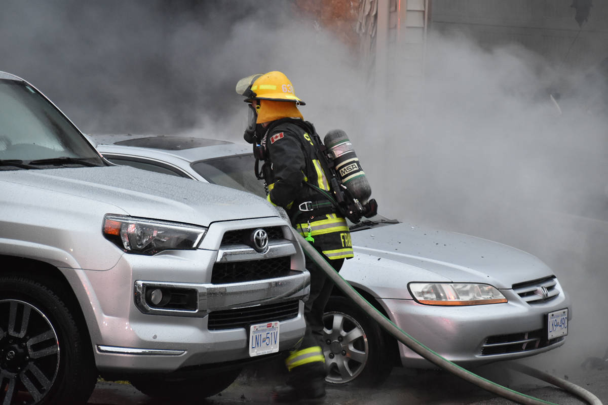 Firefighters and police responded to a fire that damaged a garage near 192nd Street and 72nd Avenue Saturday morning, Feb. 6 (Curtis Kreklau/South Fraser News Services)