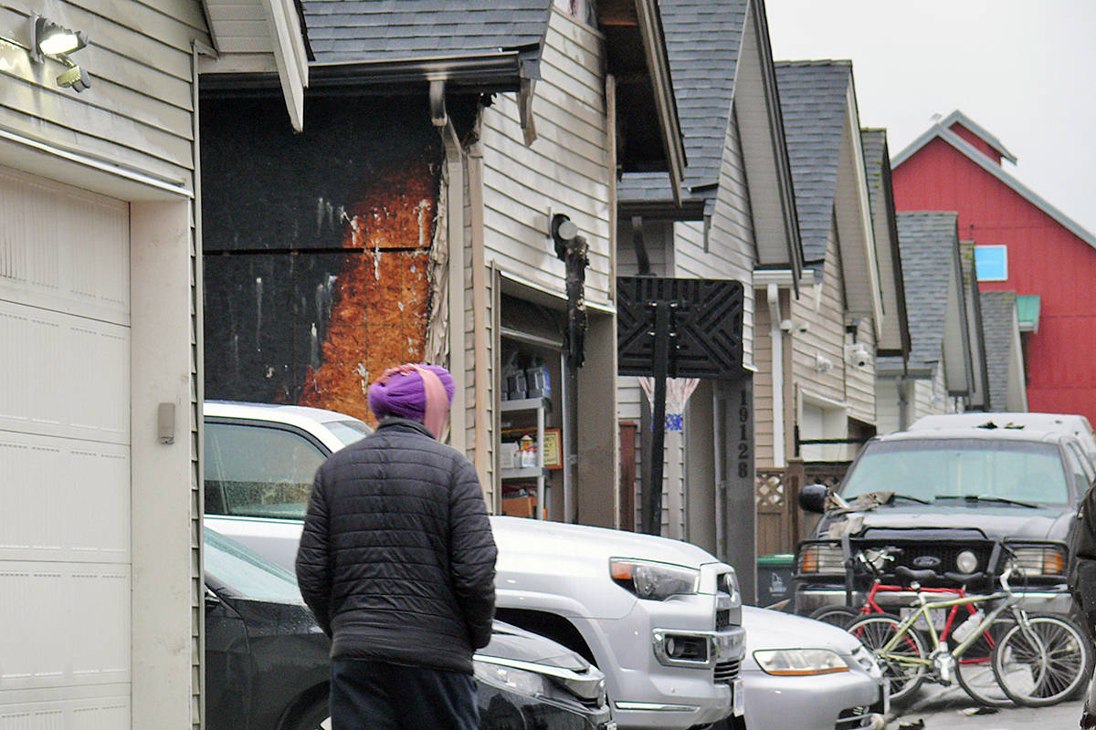 Firefighters and police responded to a fire that damaged a garage near 192nd Street and 72nd Avenue Saturday morning, Feb. 6 (Dan Ferguson/Langley Advance Times)