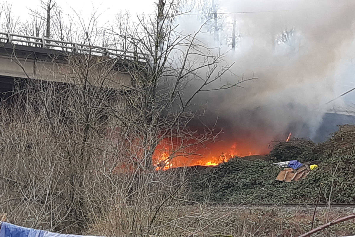 A fire broke out under the Highway 1 overpass at Riverside Road in Abbotsford on Saturday, Feb. 6, 2021. (Colleen Flanagan/ Maple Ridge News)
