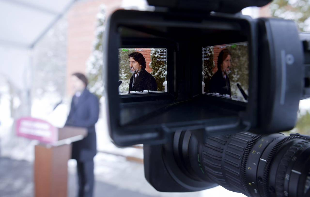 Prime Minister Justin Trudeau is seen in the viewfinder of a TV camera as he holds a news conference at Rideau Cottage in Ottawa on Friday, Feb. 5, 2021. THE CANADIAN PRESS/Sean Kilpatrick