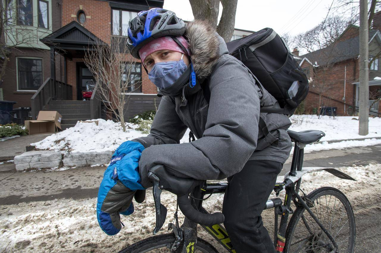 Uber Eats courier Spencer Thompson is shown in Toronto on Tuesday, February 2, 2021. THE CANADIAN PRESS/Frank Gunn