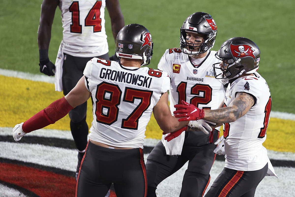 Tampa Bay Buccaneers' Rob Gronkowski (87) celebrates with Mike Evans (13) and quarterback Tom Brady (12) after Gronkowski scored a touchdown during the first half of the NFL Super Bowl 55 football game against the Kansas City Chiefs, Sunday, Feb. 7, 2021, in Tampa, Fla. (AP Photo/Mark LoMoglio)