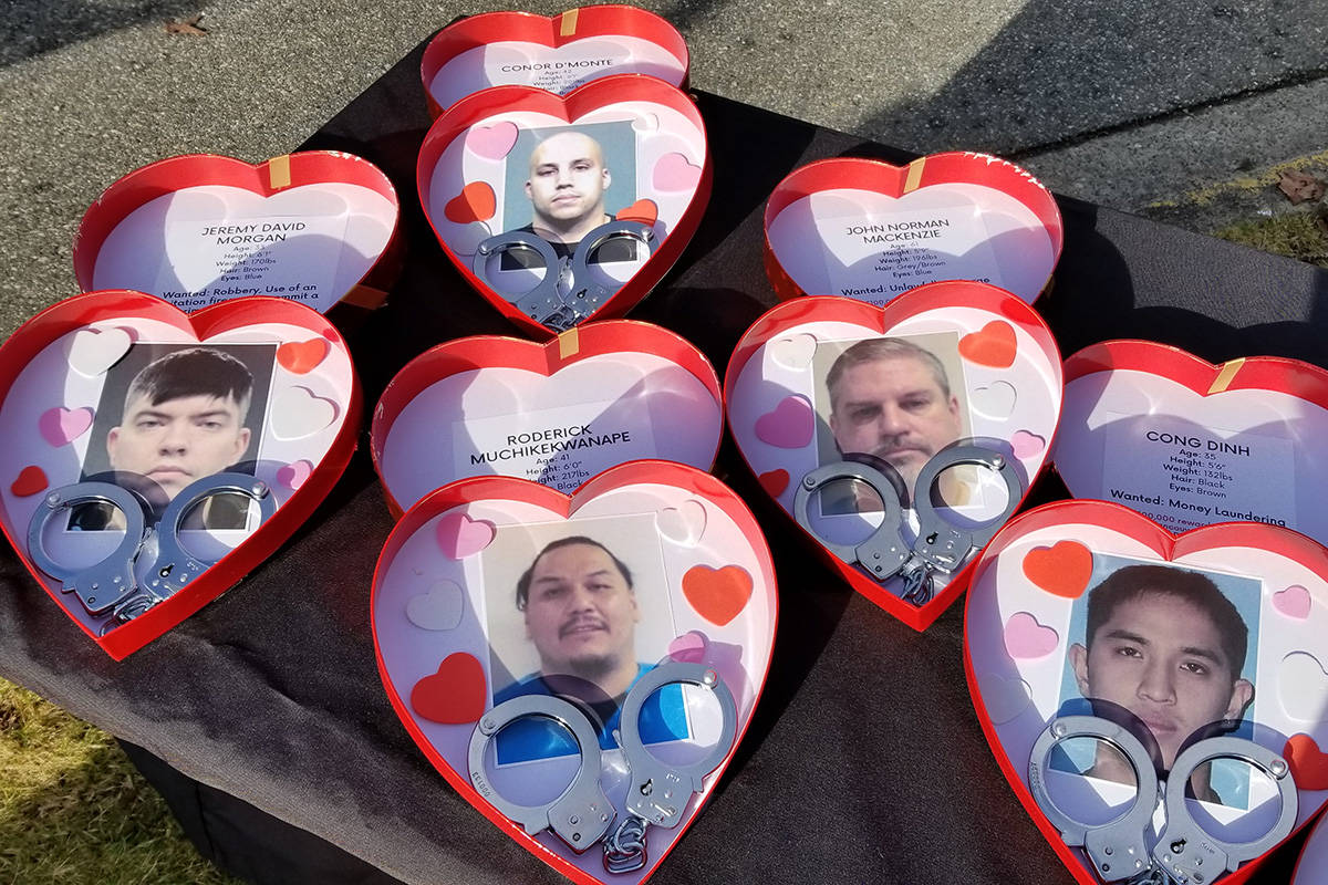 "Some of Metro Vancouver Crime Stoppers' ""least-wanted Valentines"" for 2021 displayed on a table at a media event in Surrey on Monday morning, Feb. 8. (submitted photo: Metro Vancouver Crime Stoppers)"