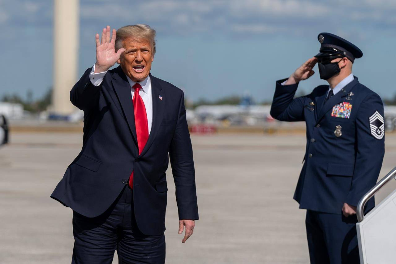 Former president Donald Trump waves to the members of the media after his final flight on Air Force 1 at Palm Beach International Airport in West Palm Beach, Fla., on Jan. 20, 2021. THE CANADIAN PRESS/AP, Manuel Balce Ceneta