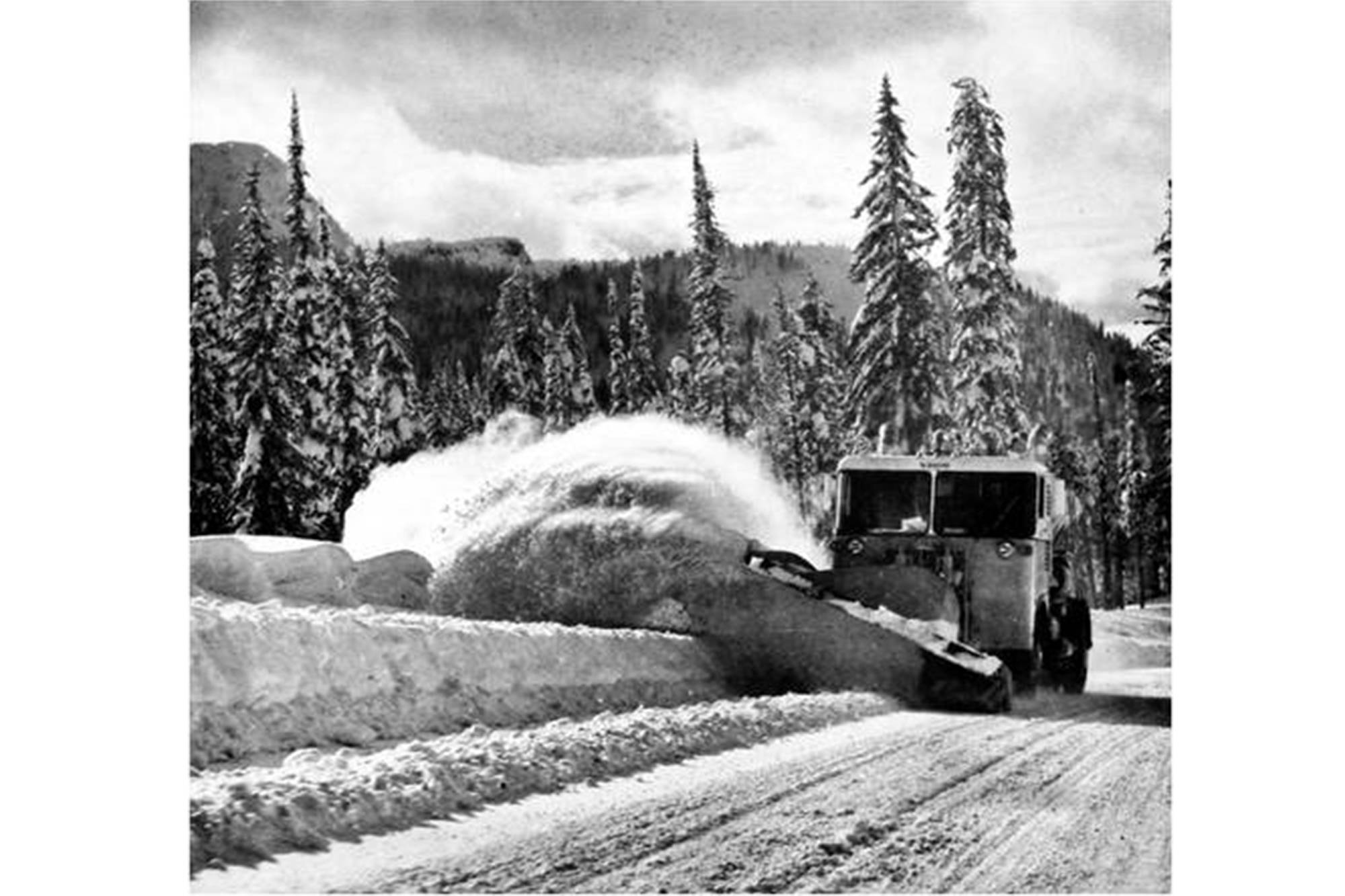 A snow plow fitted with a Pratt and Whitney ST6A turbine turboprop engine removes snow from the Kootenay Pass on Highway 3 between Creston and Salmo in the mid-1960s. (BC Ministry of Transportation and Infrastructure photo)