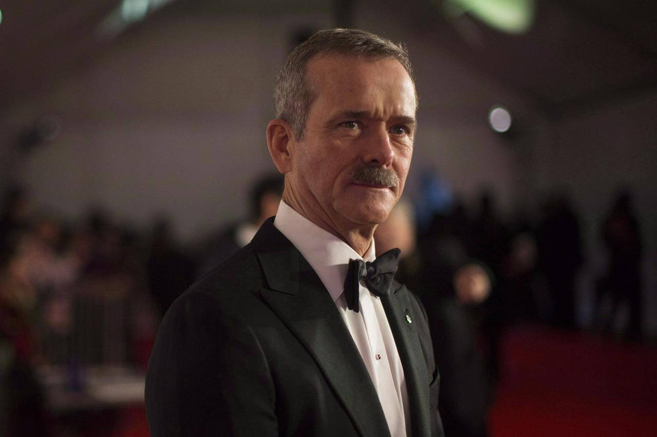 "Chris Hadfield stands on the red carpet as he Is inducted into 2018 Canada Walk of Fame during a press red carpet event in Toronto on Saturday December 1, 2018. Hadfield's next adventure will be set in the far-off world of space fiction. Random House Canada announced on Tuesday that Hadfield's debut novel, ""The Apollo Murders,"" is scheduled to hit shelves on Oct. 12.THE CANADIAN PRESS/Chris Young"
