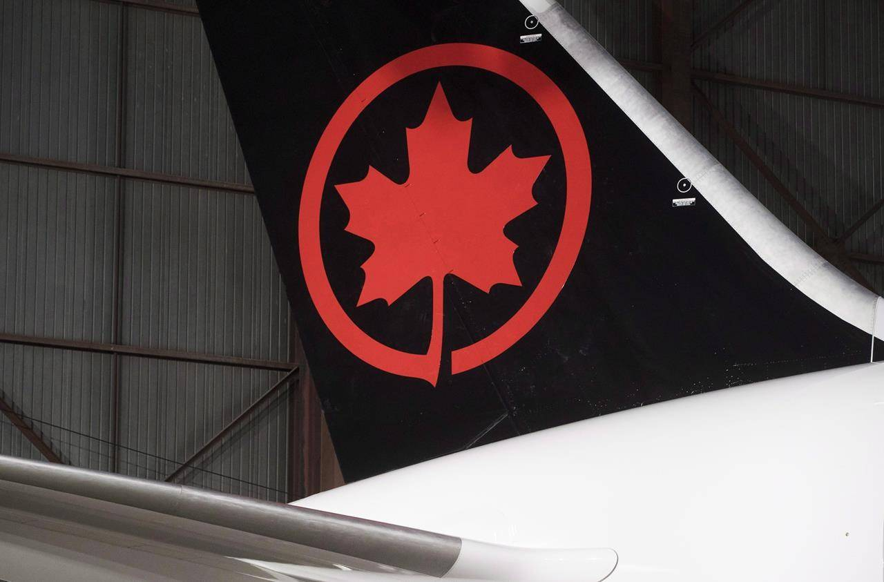 The Air Canada logo is shown on a plane at a hangar at the Toronto Pearson International Airport in Mississauga, Ont., on February 9, 2017. THE CANADIAN PRESS/Mark Blinch
