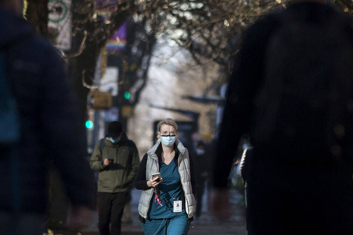 A health care worker is seen wearing a mask outside St. Paul's Hospital in Vancouver, B.C., Dec. 2, 2020. B.C. THE CANADIAN PRESS/Marissa Tiel