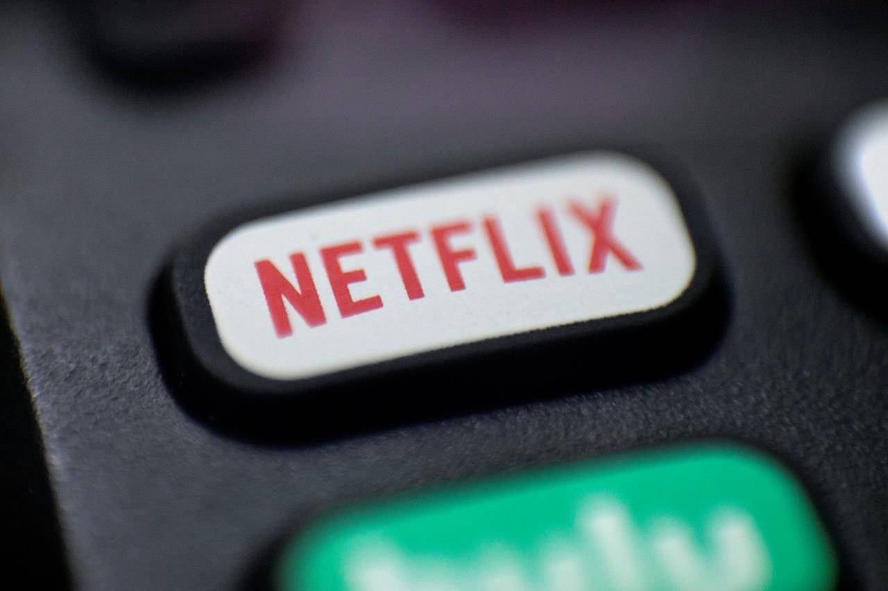 This Aug. 13, 2020 photo shows a logo for Netflix on a remote control in Portland, Ore. Netflix Inc. THE CANADIAN PRESS/AP/Jenny Kane