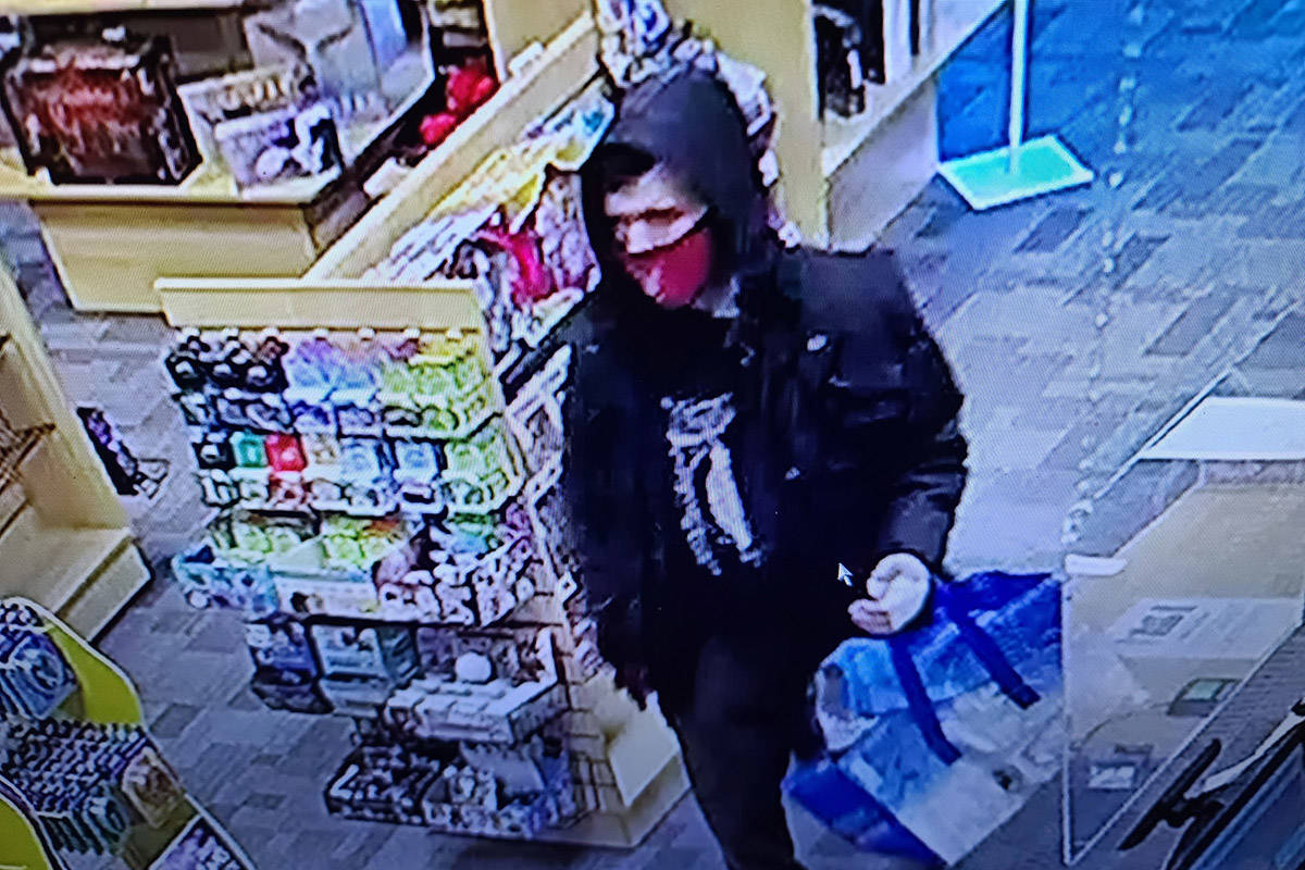 Police are looking for a man shown on a store security tape that they believe stole Magic the Gathering cards while brandishing a sword. (T&N Games)