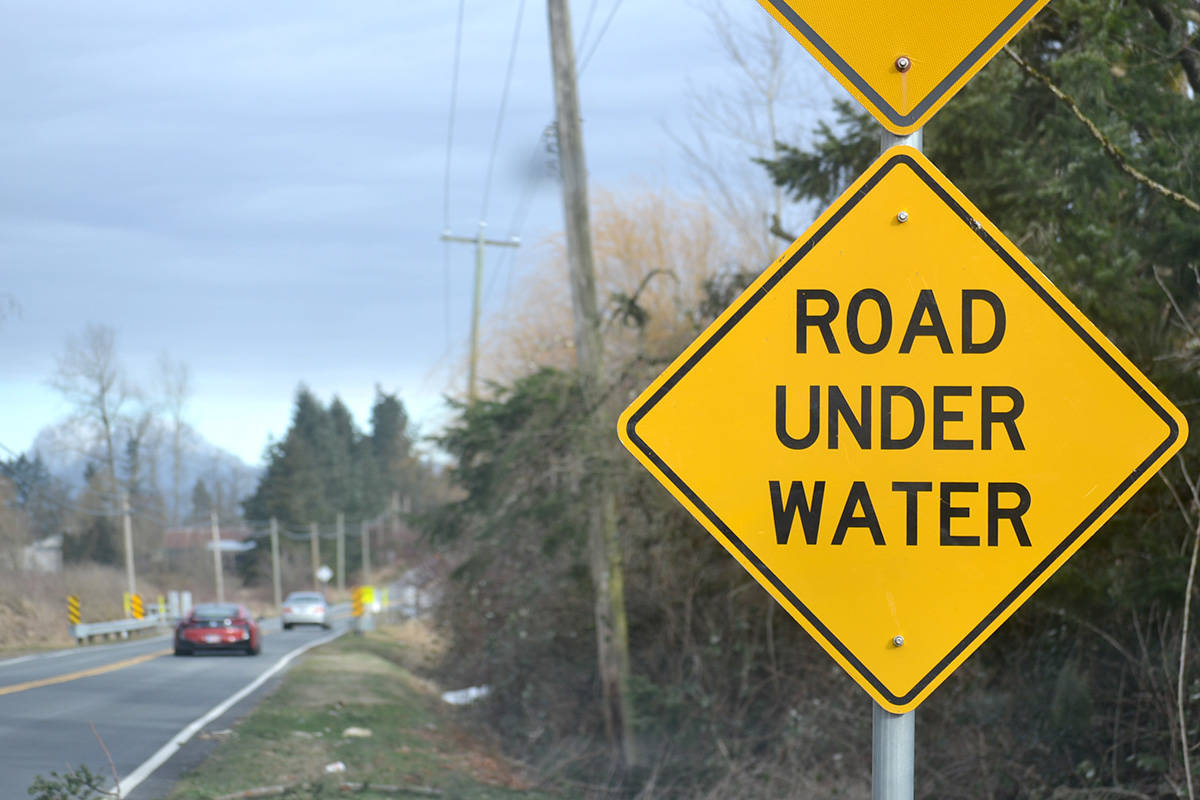Signs that warn stretch of 272nd Street is 'subject to flooding' are permanently displayed. (Ryan Uytdewilligen/Aldergrove Star)