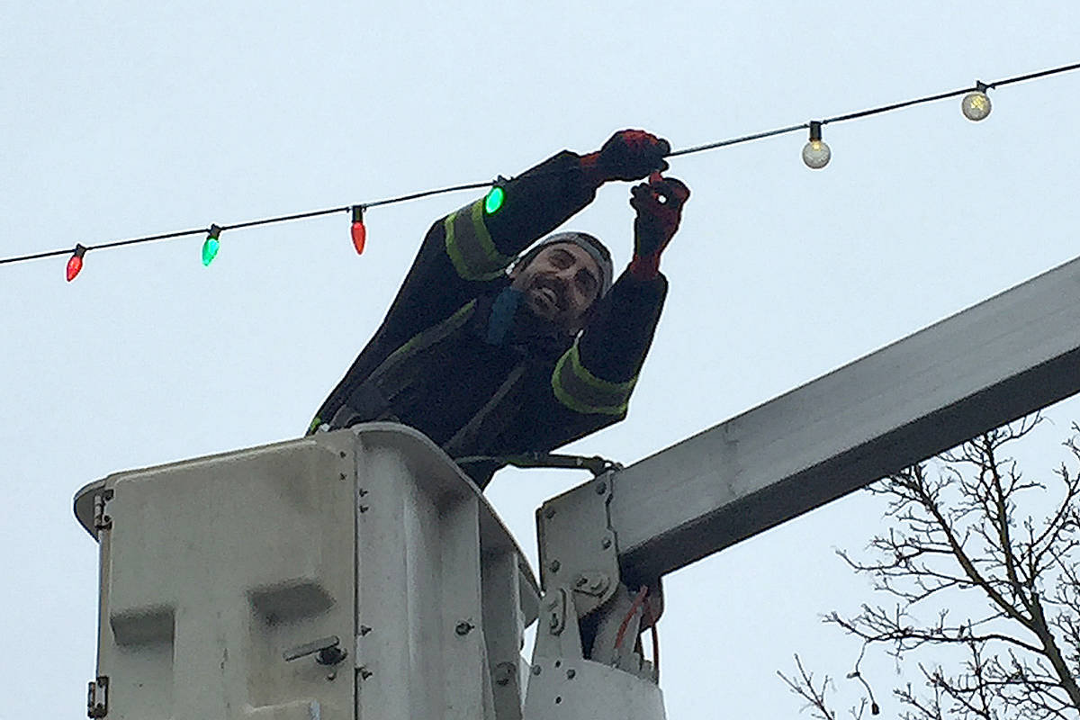 City crews will be taking lights down around the downtown this weekend. (Roxanne Hooper/Langley Advance Times)