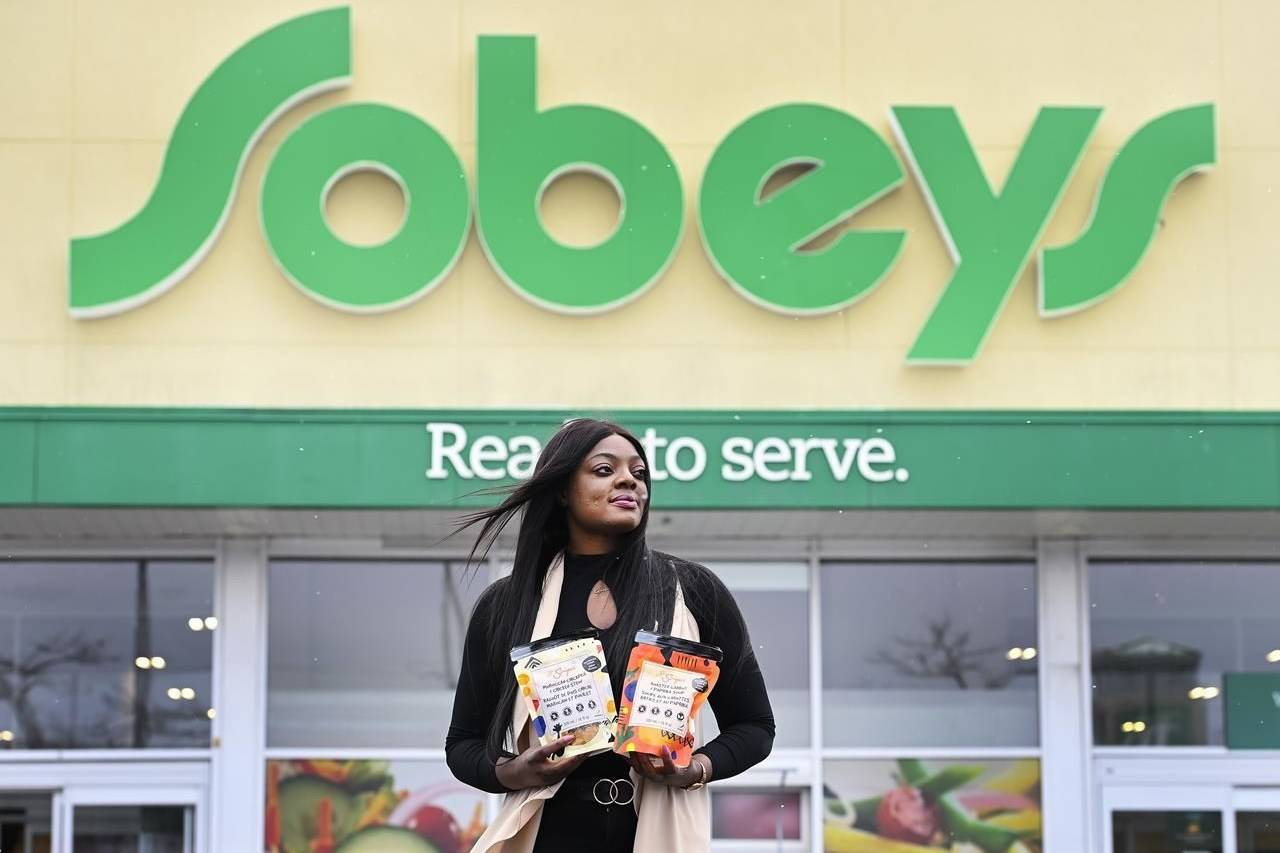 Lola Adeyemi, a Nigerian entrepreneur, poses with a few of her African soup products, which are now sold in Sobeys and other Canadian grocery retailers, in Toronto on Friday, February 5, 2021. THE CANADIAN PRESS/Nathan Denette
