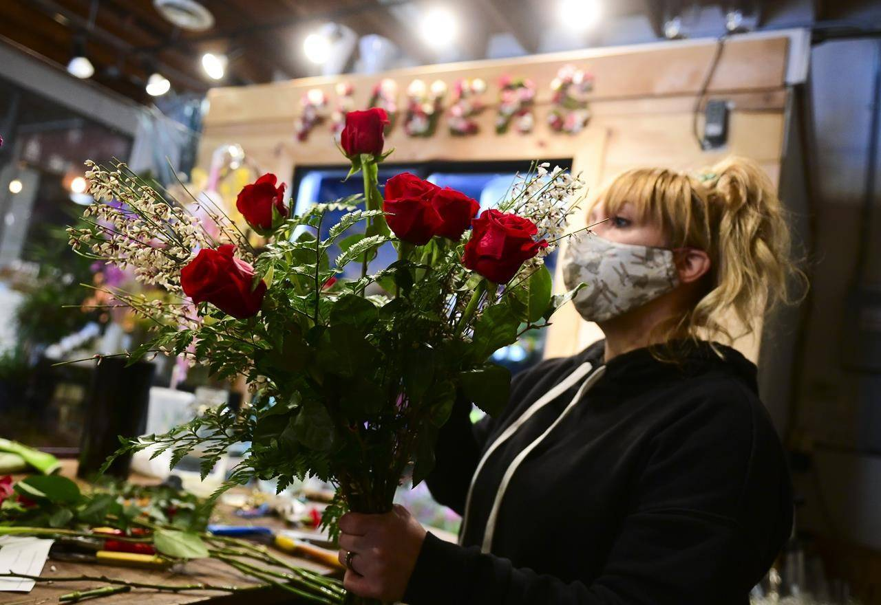 Florist Laura Logan prepares Valentines flowers at Acanthus Floral & Botanical in Almonte, Ont., on Wednesday, Feb. 10, 2021. THE CANADIAN PRESS/Sean Kilpatrick