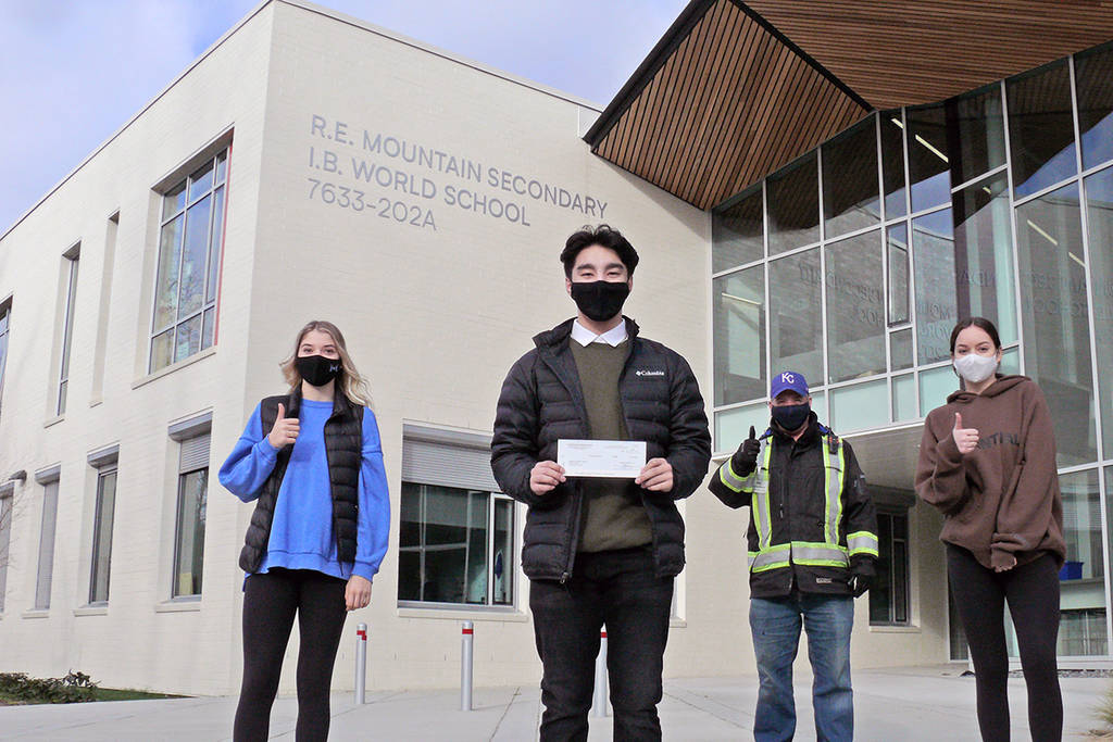 At R.E. Mountain Secondary school in Langley, Kaylyn Williams, Brandon Chow, the Food Bank's Jim Calamunce, and Julia Cotton held a socially-distant – and masked – cheque presentation (Dan Ferguson/Langley Advance Times)