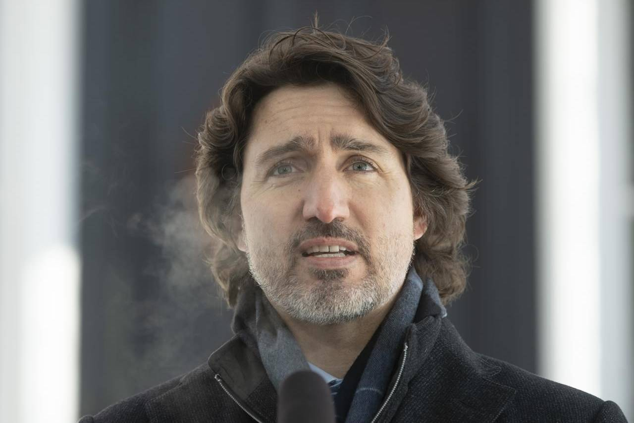 Prime Minister Justin Trudeau speaks outside Rideau Cottage on Tuesday, Feb. 9, 2021. Trudeau says the federal government will provide nearly $15 billion for public-transit projects across the country. THE CANADIAN PRESS/Adrian Wyld