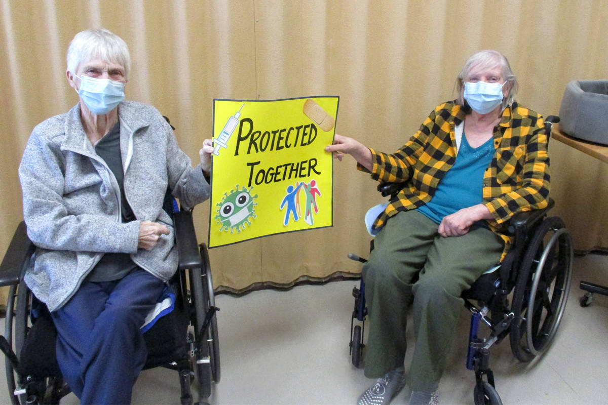 Cottonwoods Care Centre residents in Kelowna celebrate receiving their COVID-19 vaccinations. Photo: Interior Health