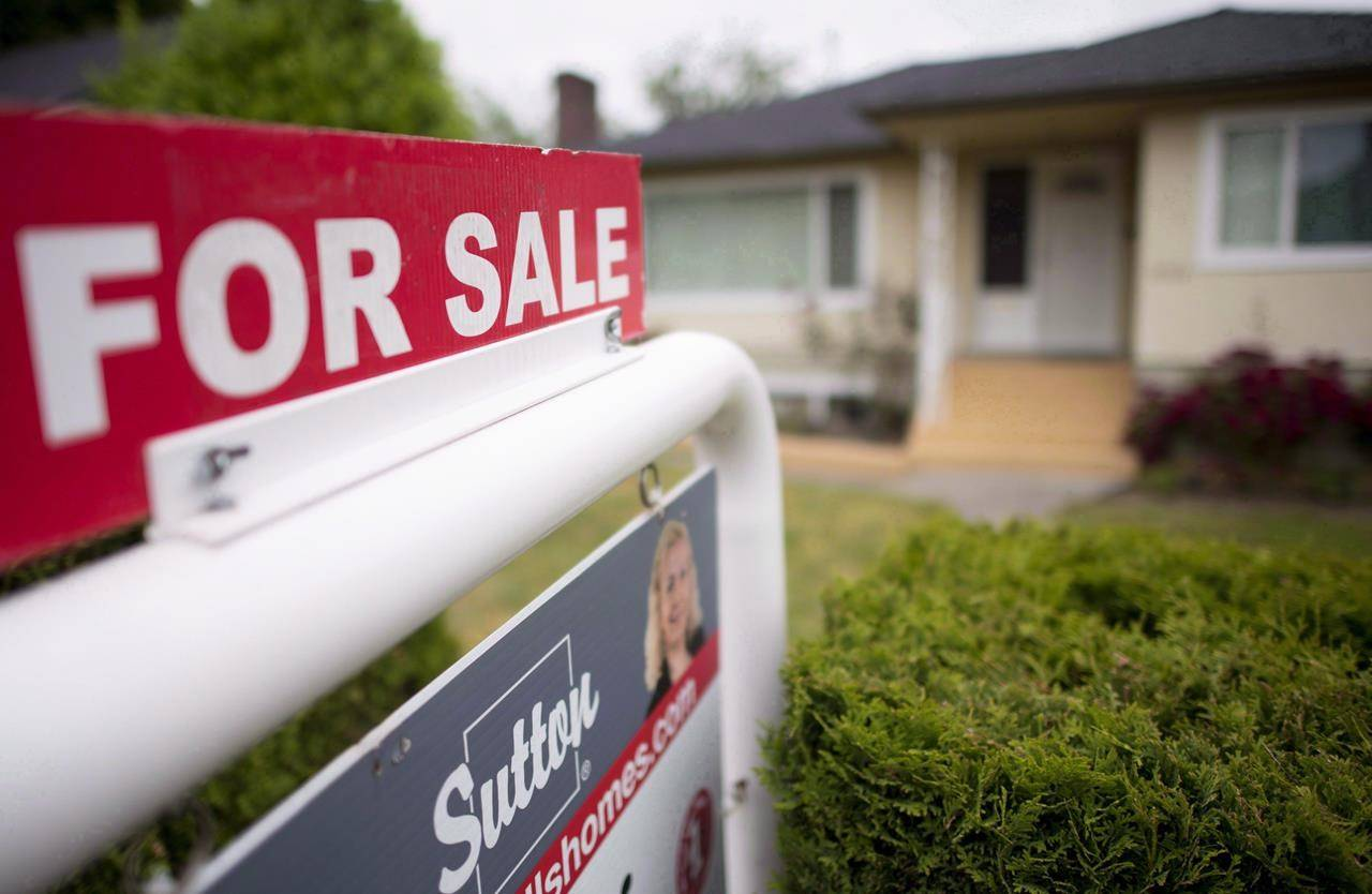 FILE – A real estate sign is pictured in Vancouver, B.C., on June, 12, 2018. THE CANADIAN PRESS Jonathan Hayward