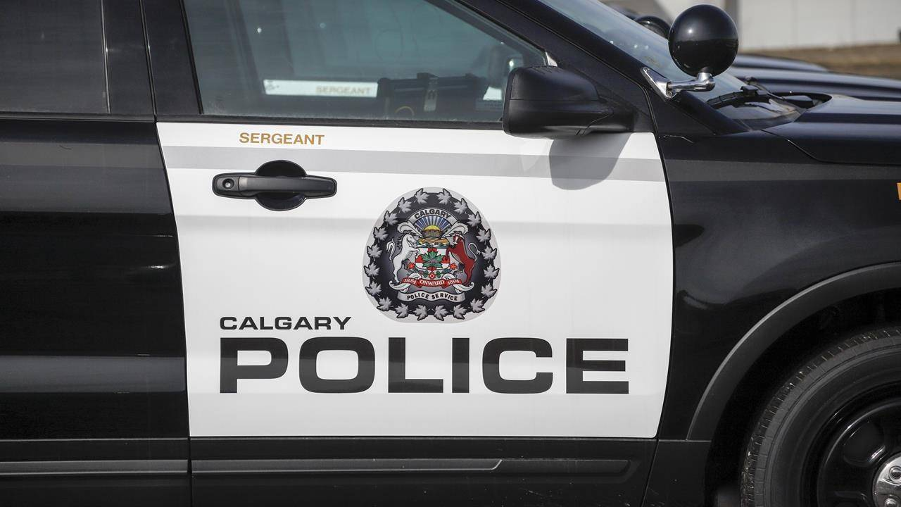 Police vehicles at Calgary Police Service headquarters in Calgary on Thursday, April 9, 2020. THE CANADIAN PRESS/Jeff McIntosh