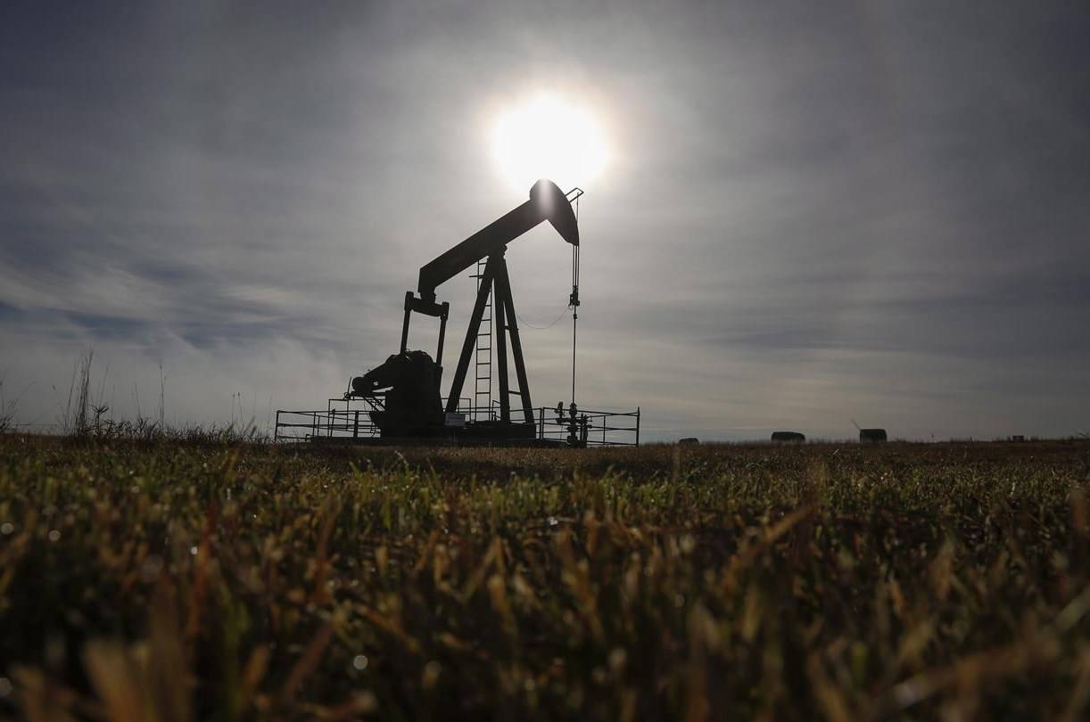 A pumpjack works at a well head on an oil and gas installation near Cremona, Alta., Saturday, Oct. 29, 2016. The latest round of applications is now open under a $100-million fund aimed at cleaning dormant oil and gas wells in British Columbia. THE CANADIAN PRESS/Jeff McIntosh