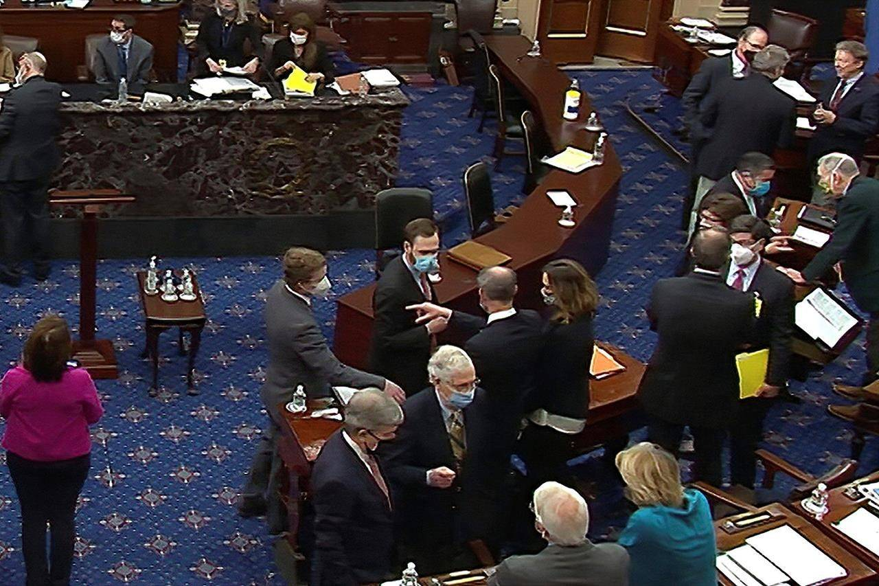 Senate Minority Leader Mitch McConnell and other Republican senators and staff talk after a vote on the motion to allow witnesses in the second impeachment trial of former President Donald Trump in the Senate at the U.S. Capitol in Washington. (AP)