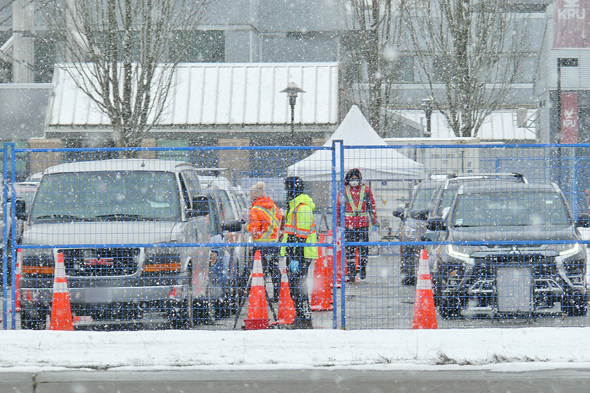Cars lined up for COVID-19 tests at the Langley test collection centre at the Kwantlen Polytechnic University campus on Saturday, Feb. 13 (Dan Ferguson/Langley Advance Times)
