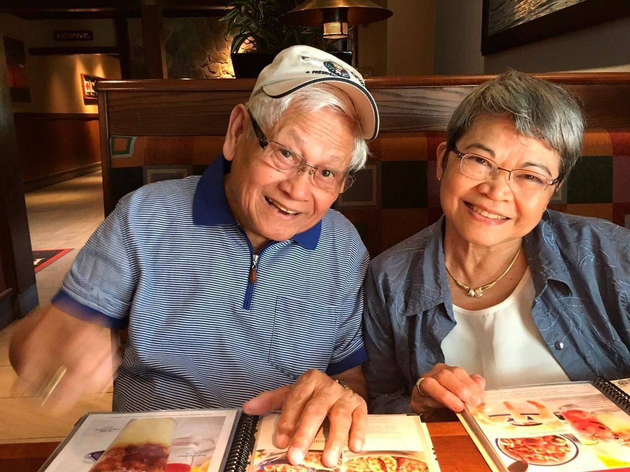 This 2018 photo provided by Cris Charbonneau shows Gil and Mercy Galicia in Beaverton, Ore. The couple have barely left their home since coronavirus lockdowns began, said their daughter, Cris Charbonneau. They had not been able to see their large, close-knit family, three children and six grandchildren spread across the country. Like many seniors, the year has been especially hard on them. (Cris Charbonneau via AP)