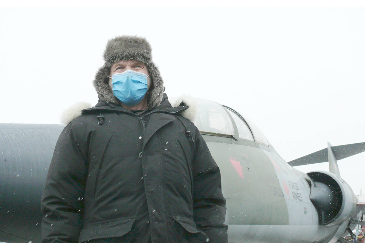 Museum president Bruce Friesen bundled up against the cold to greet visitors on to the Canadian Museum of Flight free Family Day weekend at Langley airport on Sunday, Feb. 14 (Dan Ferguson/Langley Advance Times)