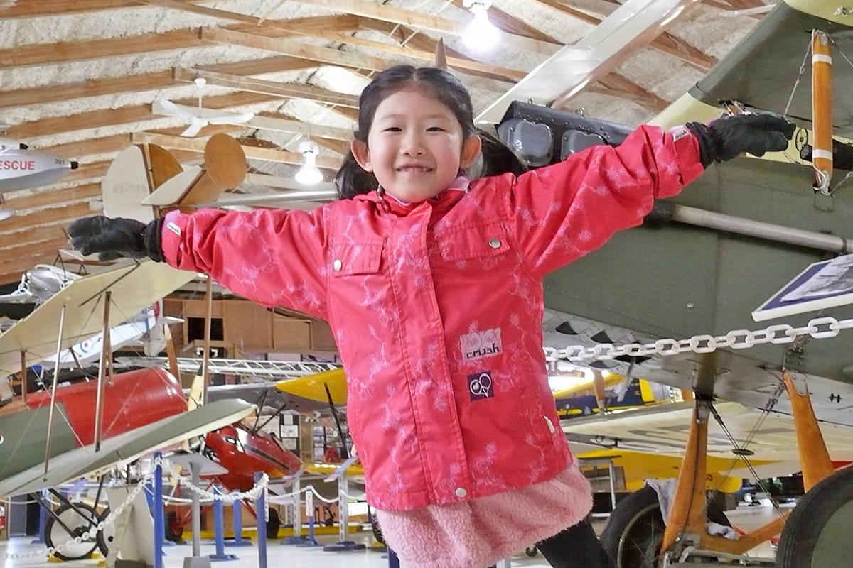 Six-year-old Harmony Kim from Willoughby demonstrated her own form of flying during her family visit to the Canadian Museum of Flight at Langley airport on Sunday, Feb. 14, (Dan Ferguson/Langley Advance Times)