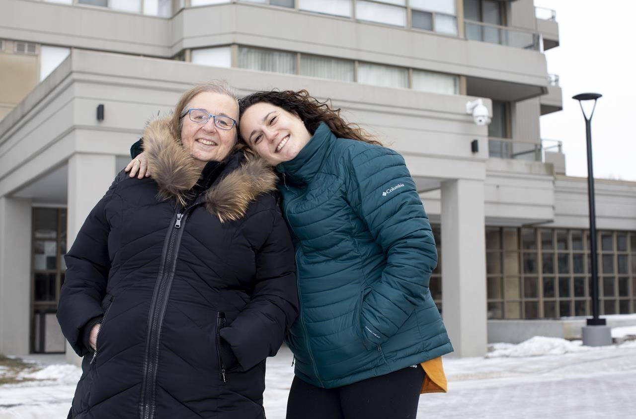 Barbara, left, and Marissa Barnartt pose for a photo outside their condo building in Thornhill, Ont. on Wednesday, February 10, 2021. THE CANADIAN PRESS/Chris Young