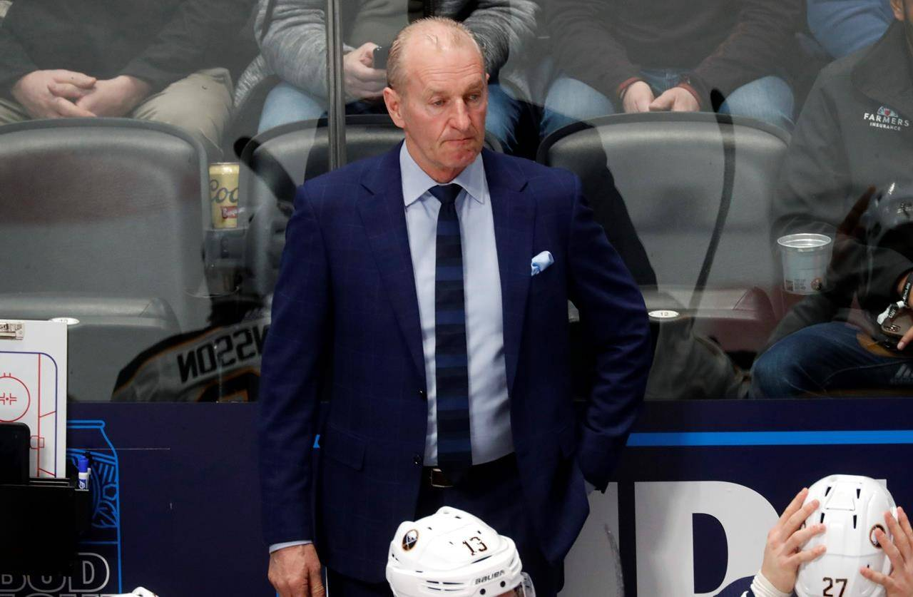 """FILE - Buffalo Sabres head coach Ralph Krueger looks on in the first period of an NHL hockey game against the Colorado Avalanche Wednesday, Feb. 26, 2020, in Denver. Krueger marked his return to practice Sunday, feb. 14, 2021 with an upbeat but cautionary message following a 10-day bout with what he called """"moderately severe symptoms"""" of COVID-19. (AP Photo/David Zalubowski, file)"""