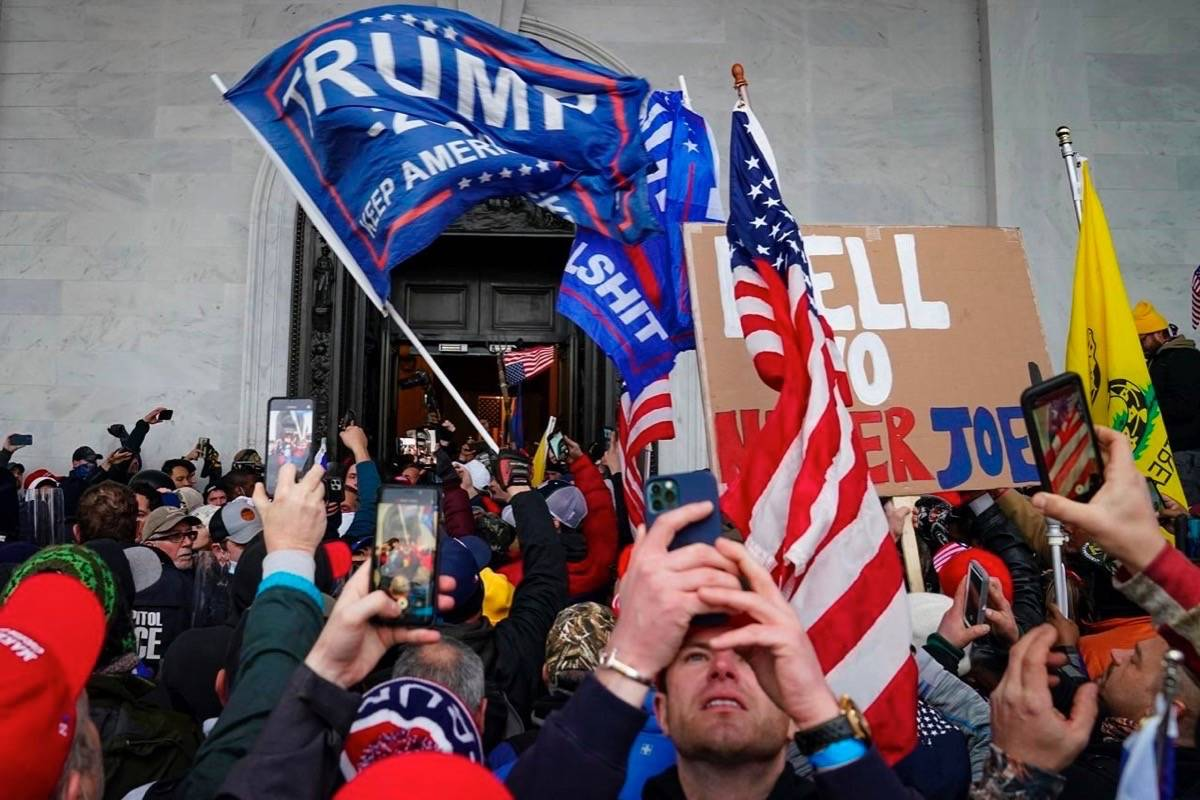 FILE - In this Jan. 6, 2021, file photo, Trump supporters gather outside the Capitol in Washington. THE CANADIAN PRESS/AP/John Minchillo, File