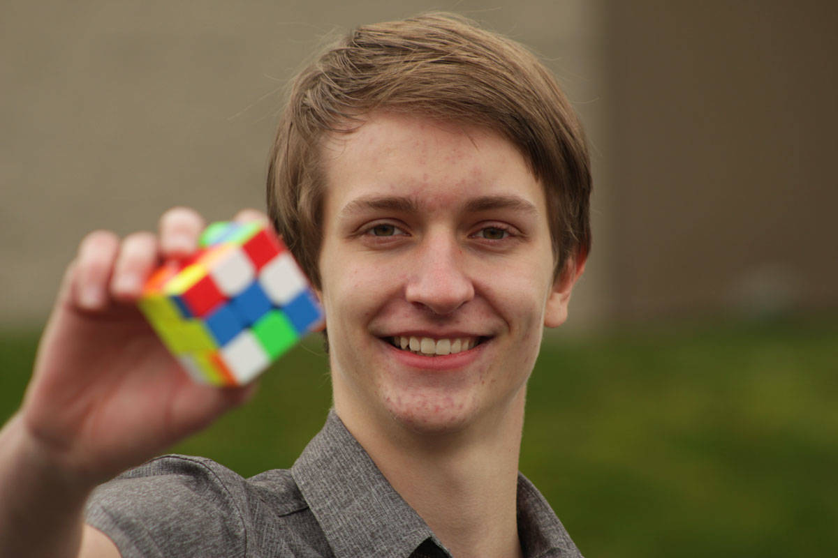 Greater Victoria high school student Josiah Plett, 18, unofficially broke the Guinness World Record for most Rubik's cubes solved while hula hooping on Feb. 13 at Pacific Christian School in Saanich. (Devon Bidal/News Staff)