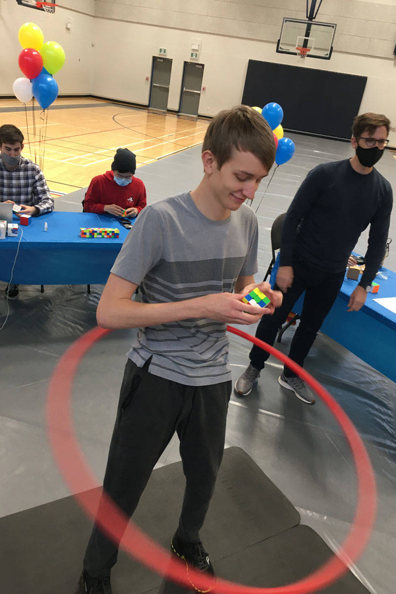 Josiah Plett, 18, unofficially broke the Guinness World Record for most Rubik's cubes solved while hula hooping on Feb. 13 at Pacific Christian School in Saanich. (Photo courtesy Alvira Plett)