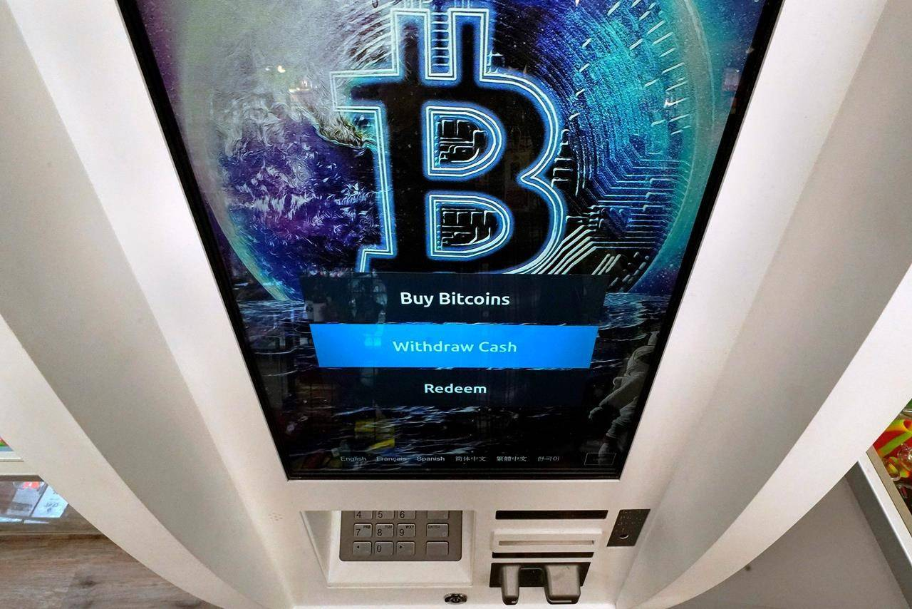 The Bitcoin logo appears on the display screen of a crypto currency ATM at the Smoker's Choice store, Tuesday, Feb. 9, 2021, in Salem, N.H. The price of Bitcoin has soared over the past months. (AP Photo/Charles Krupa)