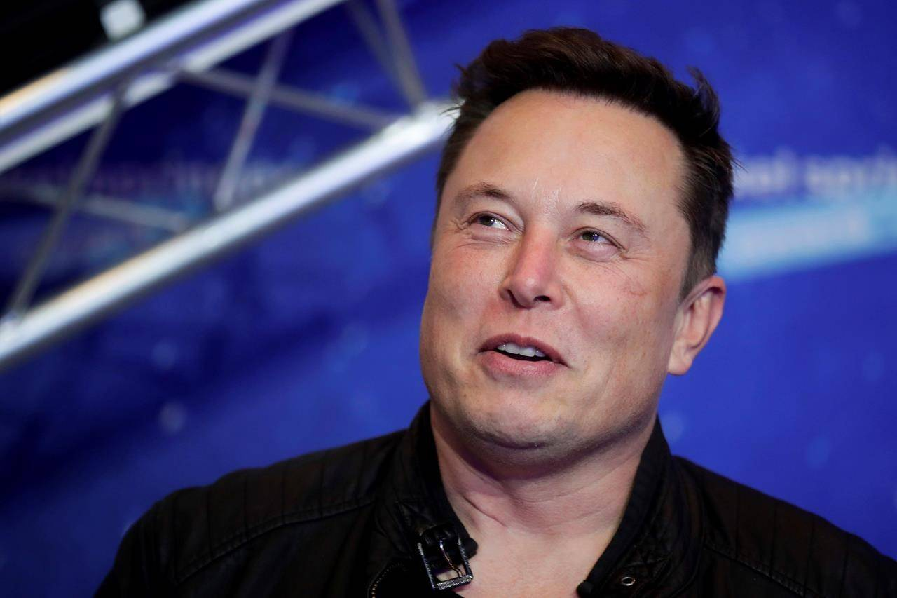 SpaceX owner and Tesla CEO Elon Musk arrives on the red carpet for the Axel Springer media award, in Berlin. Tesla says it has invested more than $1 billion in Bitcoin and will accept the digital currency as payment for its electric vehicles. (Hannibal Hanschke/AP)