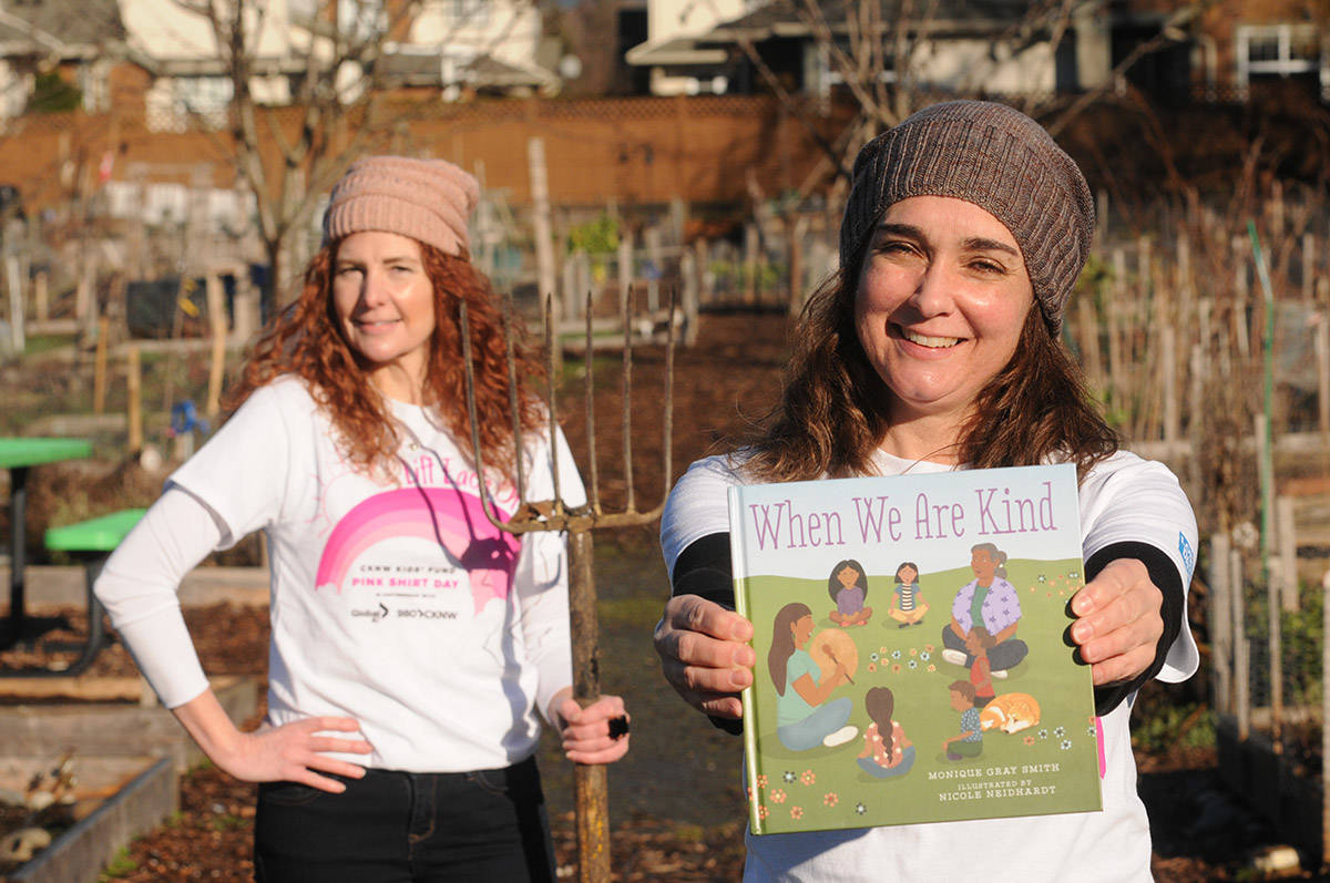 Julie Penner (left) and Janet Woyke, librarians with the Fraser Valley Regional Library in Chilliwack, have filmed a video storytime for Anti-Bullying Day (Feb. 24) where they read 'When We Are Kind.' (Jenna Hauck/ Chilliwack Progress)