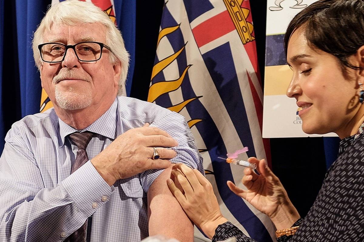 Retired provincial health officer Dr. Perry Kendall, seen here getting his seasonal flu shot in November 2015, has returned to work on an advisory committee for COVID-19 research in B.C. (B.C. government)