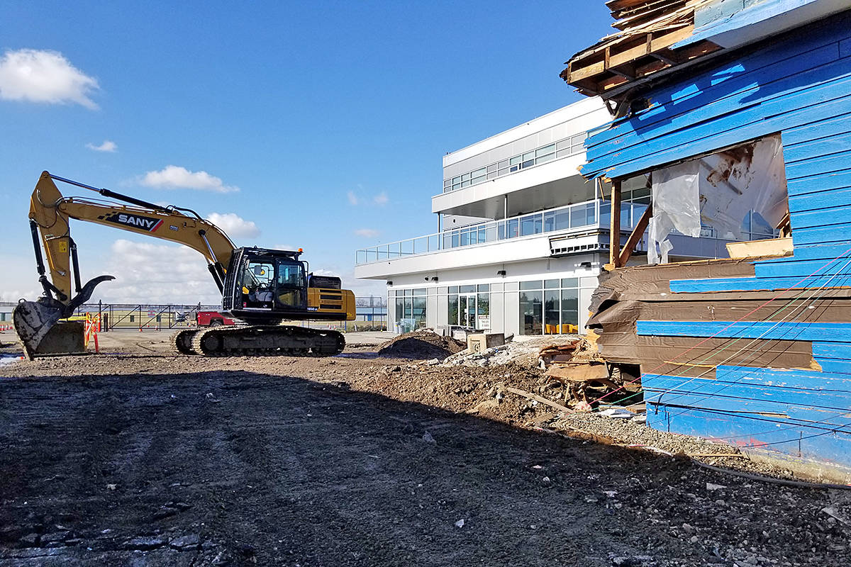 After a series of construction setbacks, a move by Adrian's at the Airport restaurant into new premises is finally about to happen, owner Demetre Exarhopoulus said. The old Adrian's was being demolished on Wednesday, Feb. 17 (Dan Ferguson/Langley Advance Times)