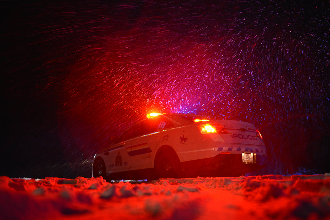 RCMP pictured at a motor vehicle incident during snowy conditions. (Phil McLachlan - Black Press Media)