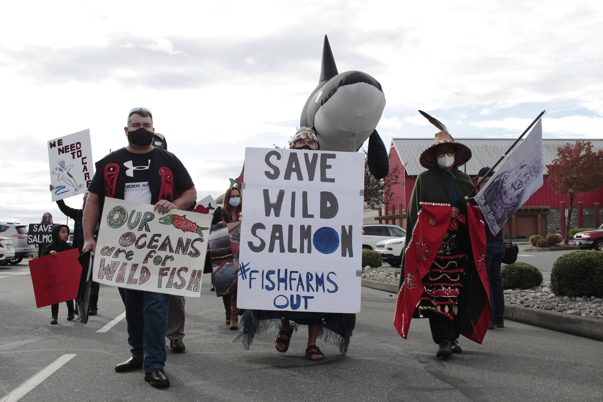 A Photo from Sept. 2020, when First Nations and wild salmon advocates took to the streets in Campbell River to protest against open-pen fish farms in B.C.'s waters. On Dec. 17, federal fisheries minister Bernadette Jordan announced her decision to phase out 19 fish farms from Discovery Islands. (Marc Kitteringham/Campbell River Mirror)
