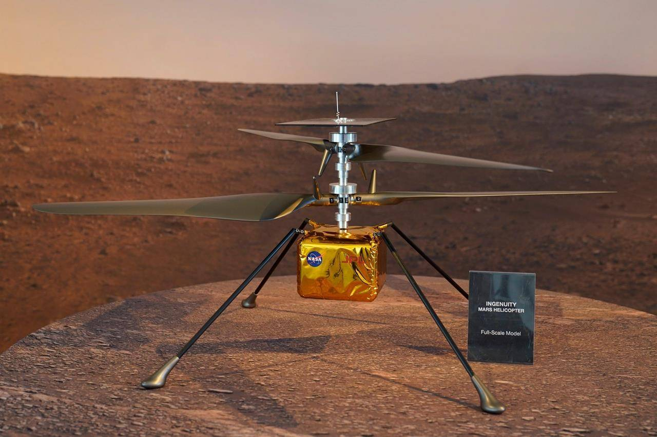 A full-scale model of the Mars Helicopter Ingenuity is displayed for the media at NASA's Jet Propulsion Laboratory (JPL) Wednesday, Feb. 17, 2021, in Pasadena, Calif. (AP Photo/Damian Dovarganes)