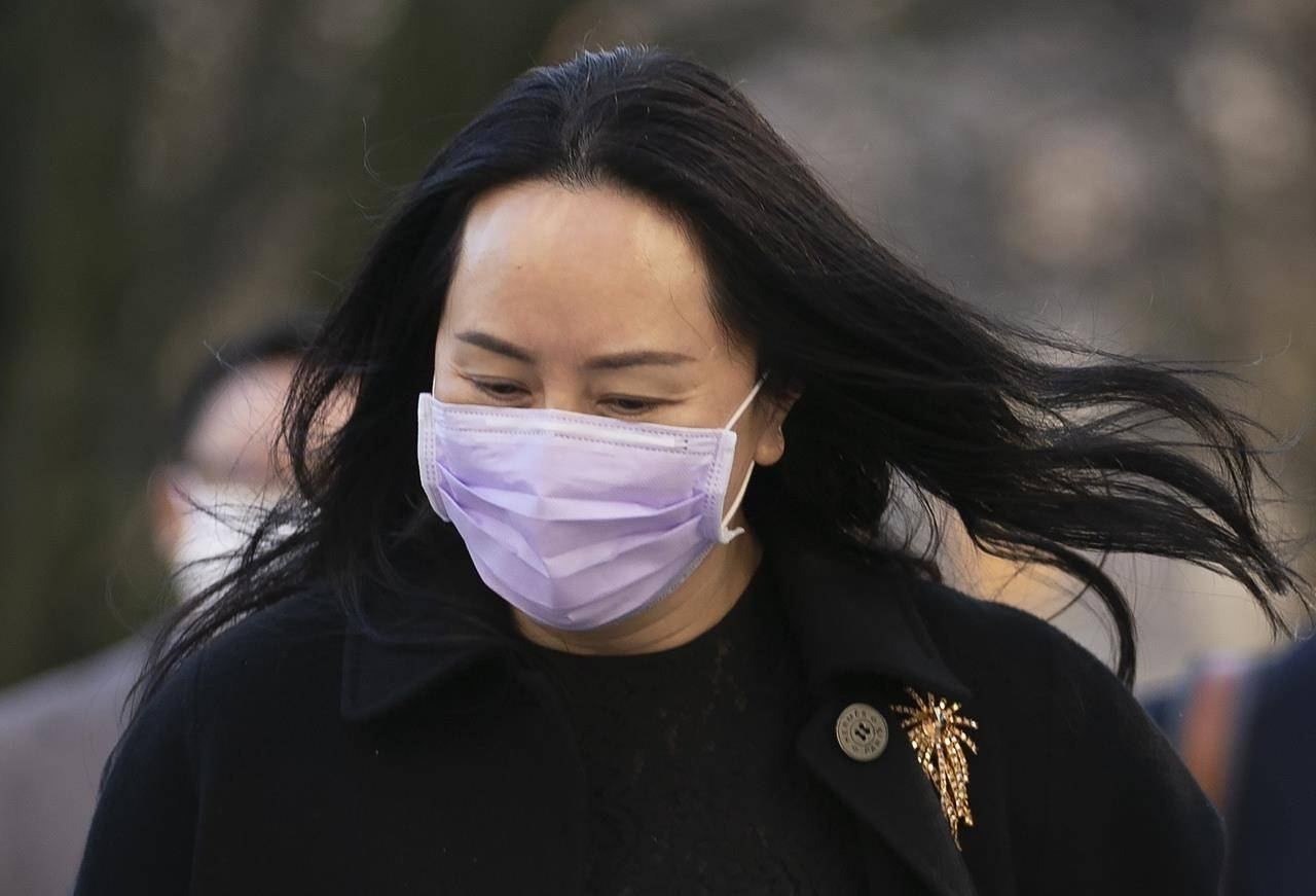 Meng Wanzhou, chief financial officer of Huawei, leaves B.C. Supreme Court during a break from a hearing in Vancouver, Wednesday, January 13, 2021. THE CANADIAN PRESS/Jonathan Hayward