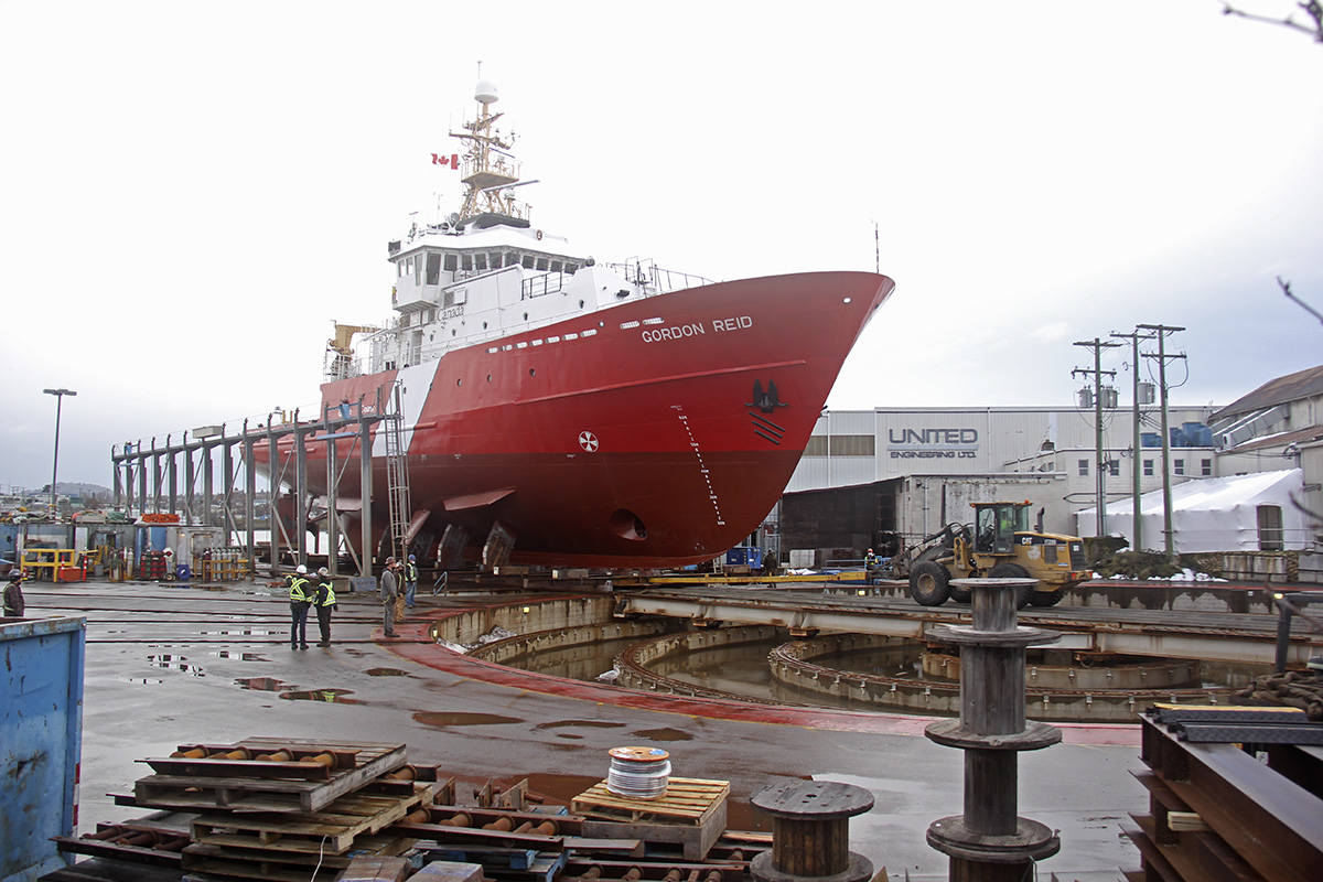 An old Highway Thru Hell heavy wrecker tow truck helps to shift an 850-tonne Canadian Coast Guard ship into launching position at the Point Hope Maritime shipyard Thursday afternoon. (Jane Skrypnek/News Staff)