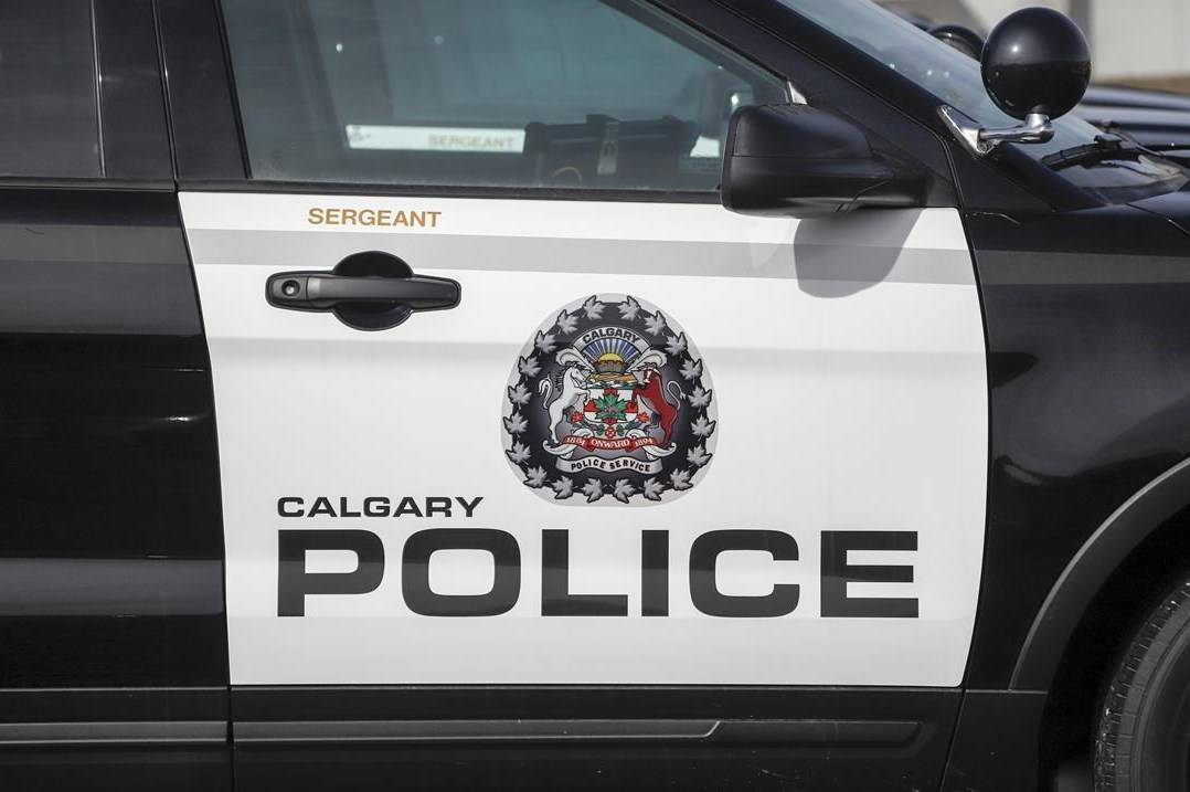Police vehicles at Calgary Police Service headquarters on April 9, 2020. Calgary police have charged a man in the sex assaults of six students when he was a junior high school teacher two decades ago. THE CANADIAN PRESS/Jeff McIntosh