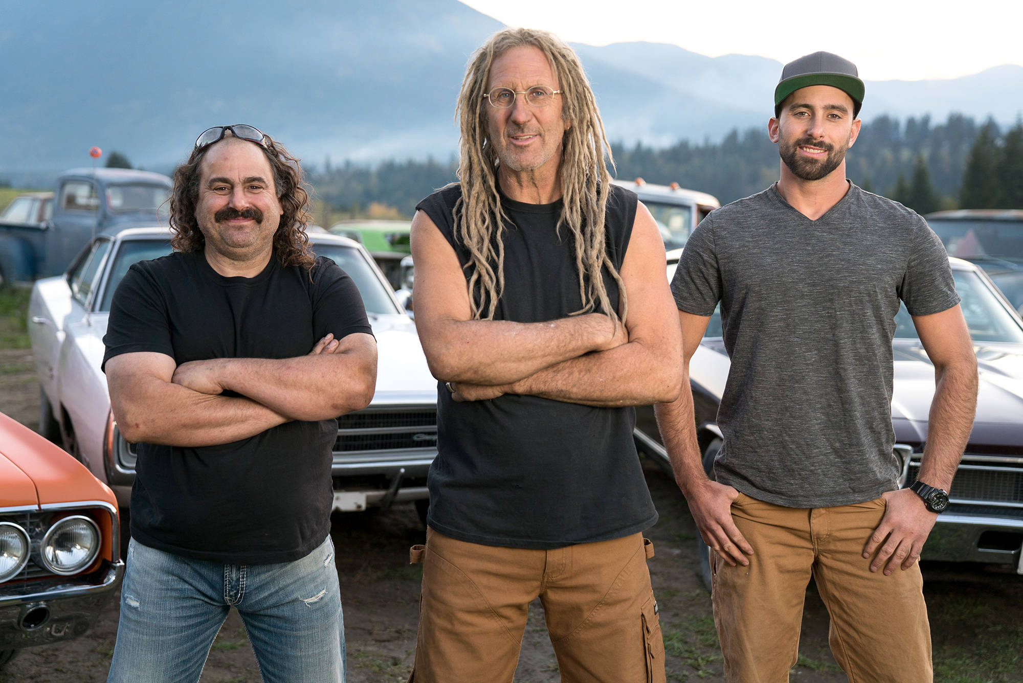 Avery Shoaf, Mike Hall and son Connor Hall, amidst the massive collection of cars at Mike's property near Tappen, are returning TV with Season 3 of Rust Valley Restorers. (Contributed)