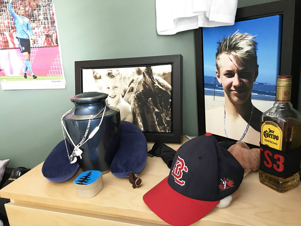 Framed photos of Travis Selje and other items fill the top of a dresser in his bedroom. (Photo: Tom Zillich)