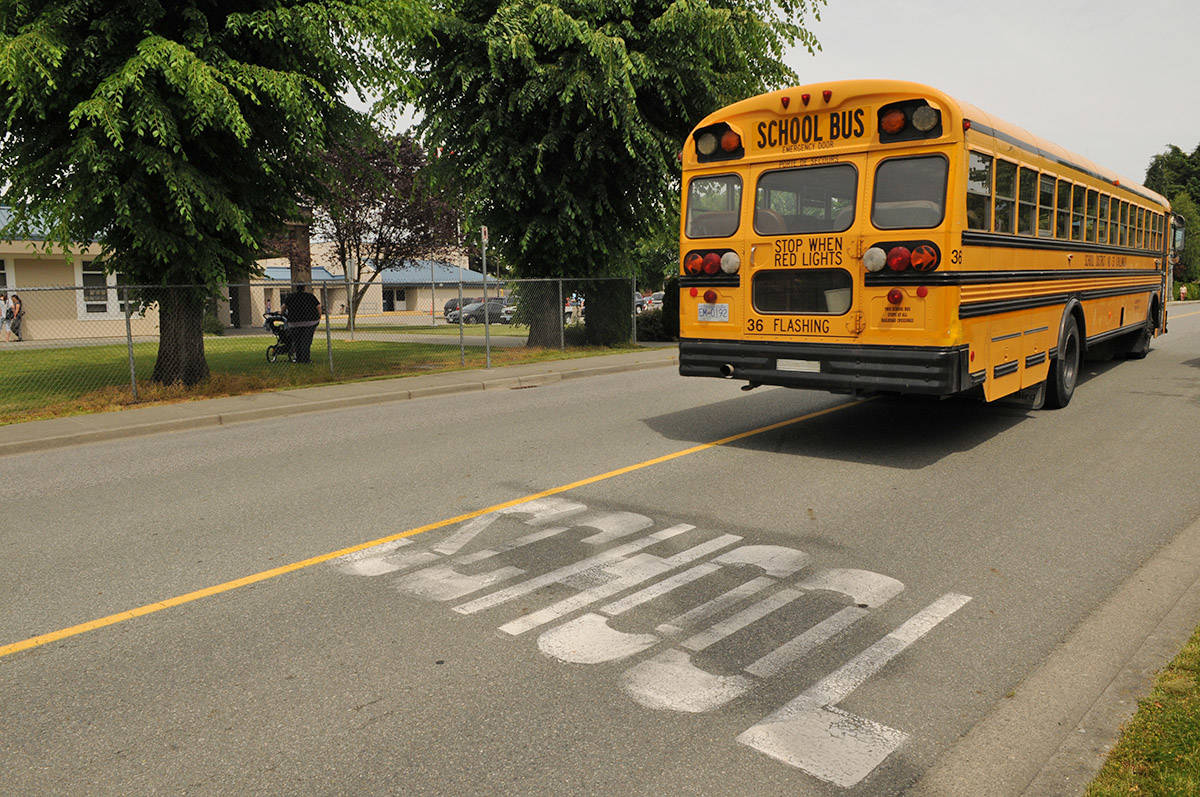 Chilliwack School District school bus outside Sardis elementary on June 11, 2014. (Jenna Hauck/ Chilliwack Progress file)