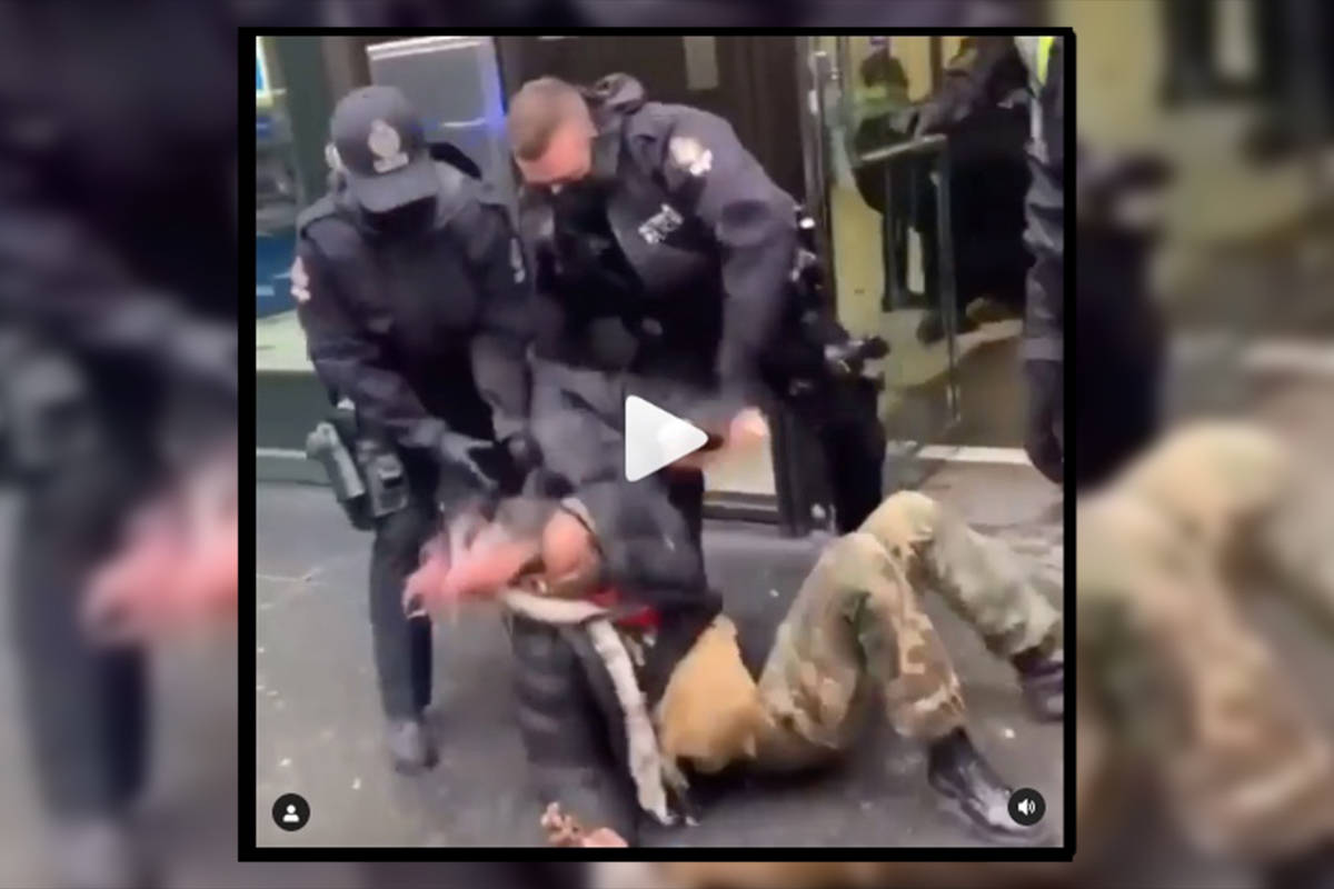 Screenshot from a video showing police removing protestors from the BMO building in Vancouver. (Instagram)